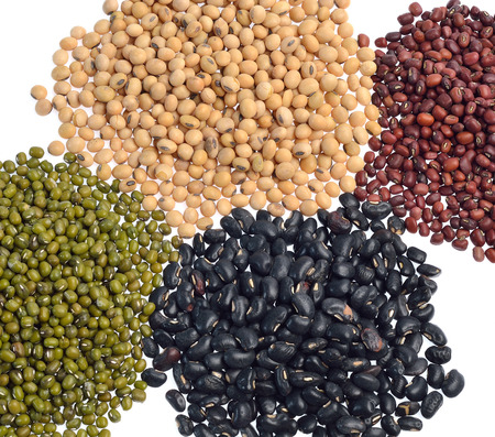 Mixture of beans, peas isolated on white background photo