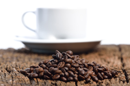 xwhite: Coffee cup and beans on a white background Stock Photo