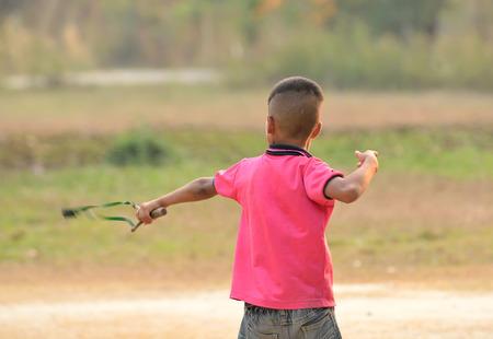 rowdy: Funny kid shooting wooden slingshot