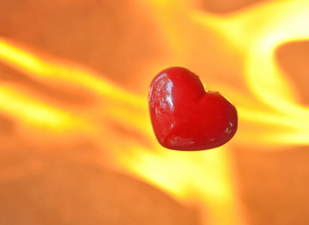 burning heart: Burning heart with flames against fire  Stock Photo