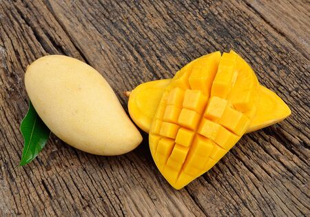 sliced fruit: Mango on a wooden