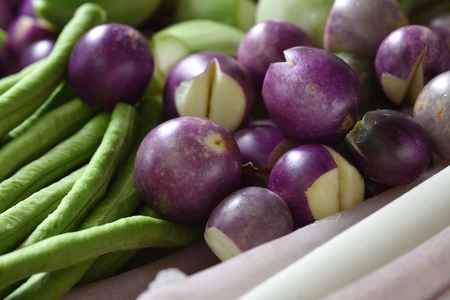 Fresh eggplant and lentils are bright green. Stock Photo