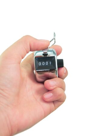 tally: hand clicks a tally counter to number one in isolated background Stock Photo