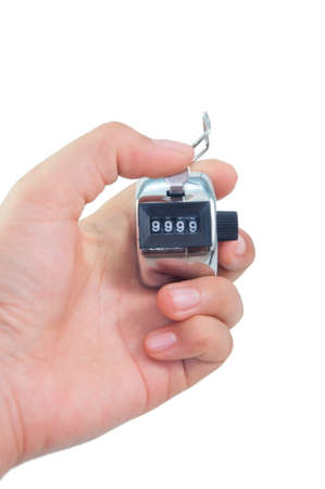 tally: hand clicks a tally counter to number 9999 in isolated background Stock Photo