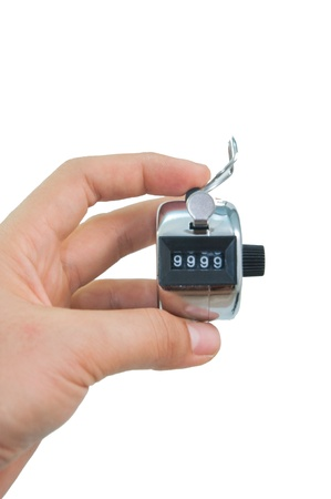 tally: hand holds a tally counter to number 9999 in isolated background Stock Photo
