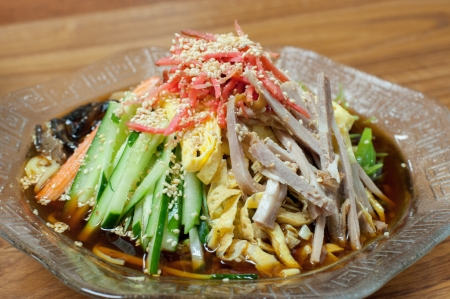 cold noodle with vegetables,egg, pork,ginger and shrimp photo