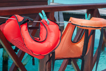lifevest: the life vests hang on a clothesline