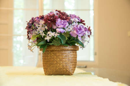 faked: closed up the faked purple flower on vase Stock Photo