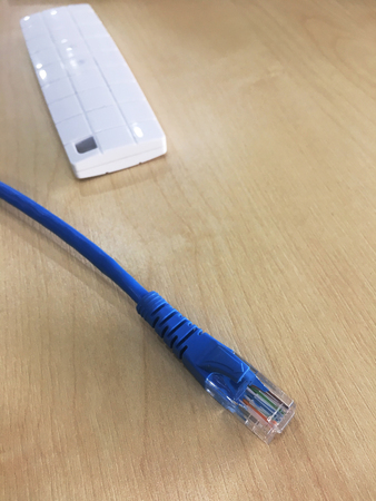 closed up the LAN cable on a table Stock Photo