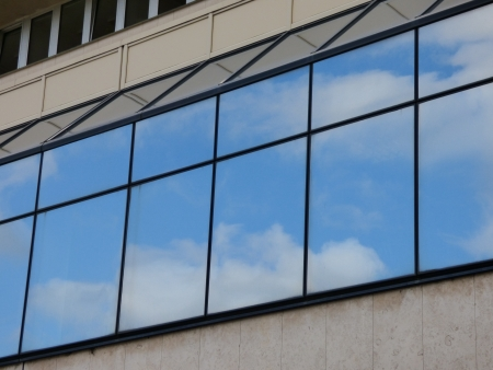 Clouds reflecting in windows photo
