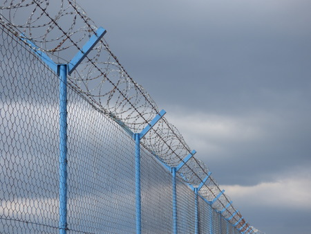 fencing wire: Fence with barbed wire Stock Photo