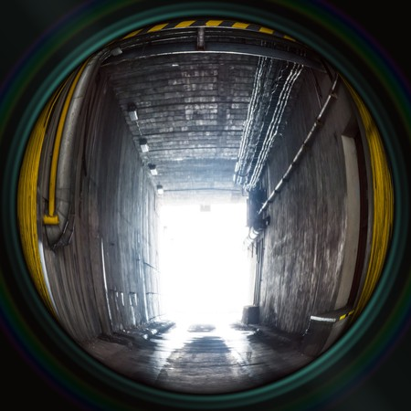 underpass: Industrial underpass with entrance gate in objective lens Stock Photo