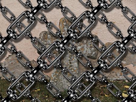 festones: Cadena de hierro con la cruz en el cementerio Foto de archivo