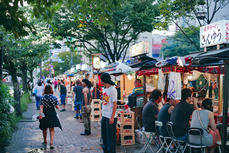 FUKUOKA, JAPAN - JUNE 14 : fukuoka's famous food stalls (yatai) located along the river on Nakasu Island
