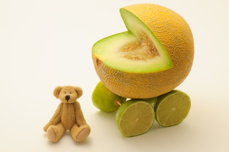 fantasize: Funny card with melon buggy and teddy bear. Stock Photo