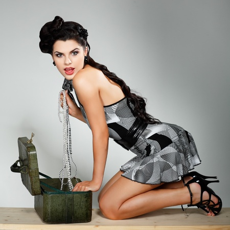 A photo of beautiful brunette is in style of pinup, glamur photo