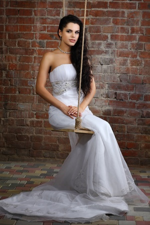 Girl is in wedding dress photo