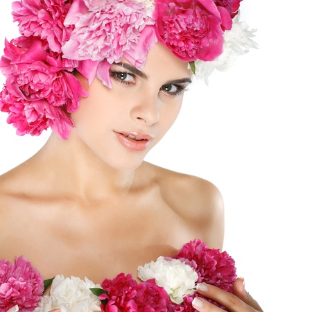 beautiful young girl with pink flowers photo
