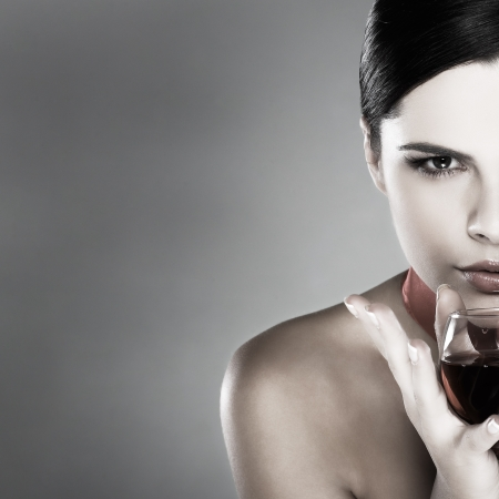 beautiful young girl  with  glass of wine photo