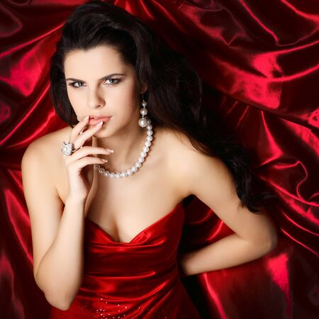 A beautiful young woman is in red clothes photo