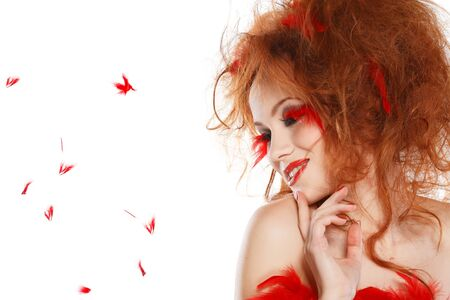 beautiful redheaded girl with red feathers photo