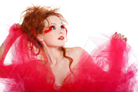 beautiful redheaded girl with red feathers Stock Photo - 10358086
