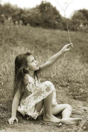 Little girl a park near the river photo