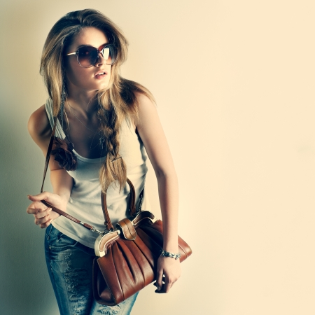 A photo of beautiful girl is in fashion style photo