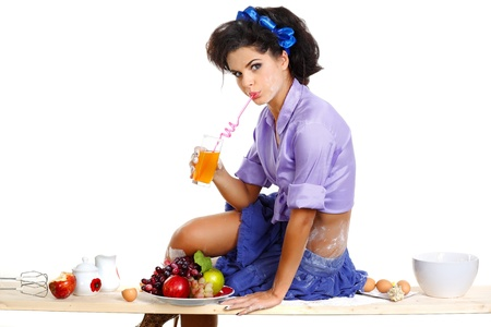 glamur: beautiful  brunette on a kitchen table