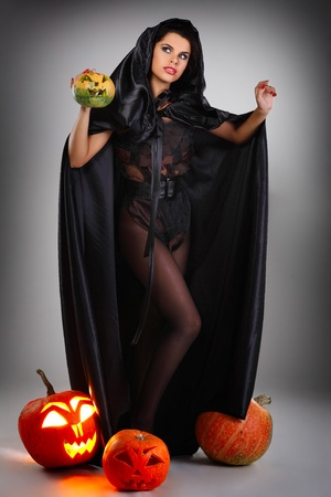 brunette in the suit of witch in night of Halloween Stock Photo - 10417611