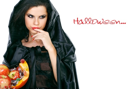 brunette in the suit of witch in night of Halloween Stock Photo - 10417603