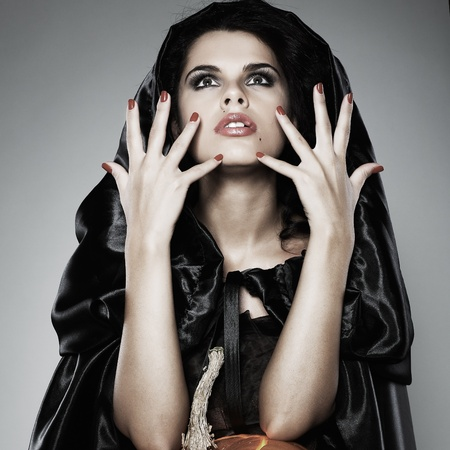 Sexual brunette in the suit of witch in night of Halloween Stock Photo - 10508657