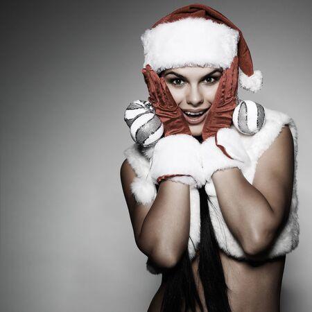 Beautiful and sexy woman wearing santa clause costume Stock Photo - 10547711