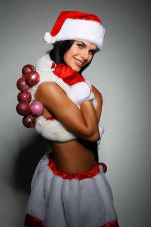 Beautiful and sexy woman wearing santa clause costume Stock Photo - 10547743
