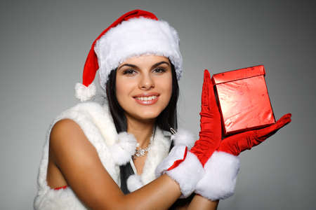 Beautiful and sexy woman wearing santa clause costume Stock Photo - 10549542