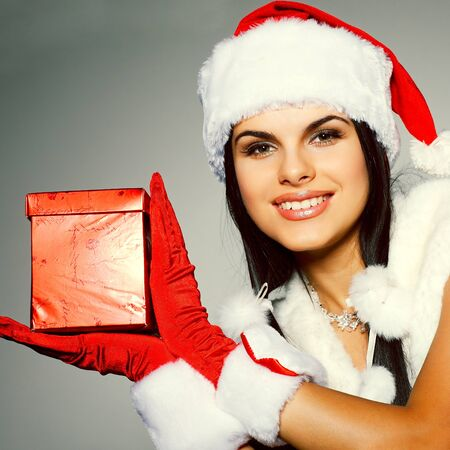Beautiful and sexy woman wearing santa clause costume Stock Photo - 10549547