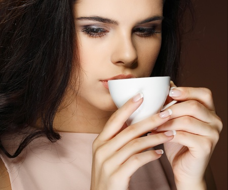 beautiful young girl  with  the cup of coffee Stock Photo - 10547771