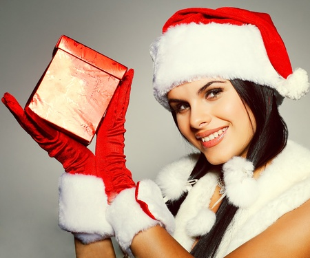 Beautiful and sexy woman wearing santa clause costume Stock Photo - 10567644