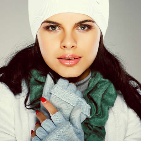 A photo of beautiful girl is in winter clothes photo