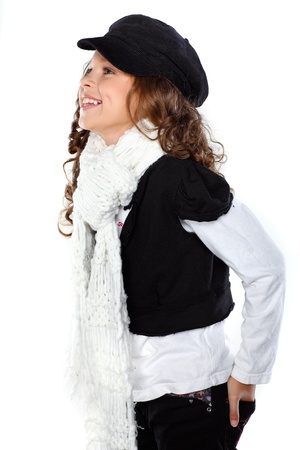 A little beautiful girl is in autumn clothes, isolated on a white background photo