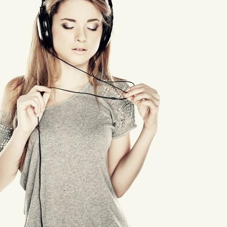 Hermosa chica con auriculares Foto de archivo