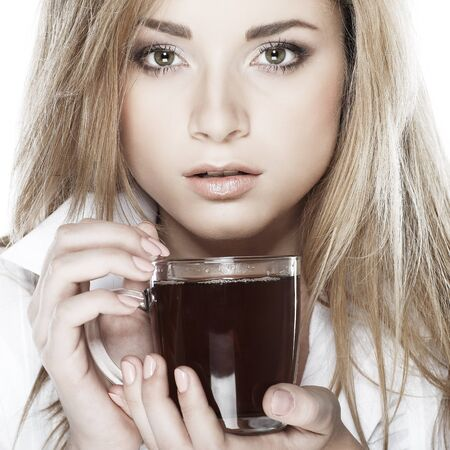 beautiful young girl  with  the cup of tea photo
