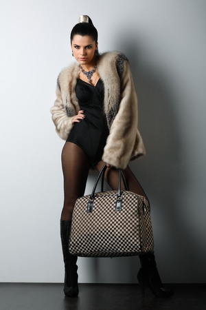 A photo of sexual beautiful girl is in fashion style photo