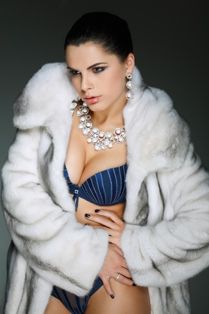 A photo of sexual beautiful girl is in fashion style, lingerie, fur coat photo