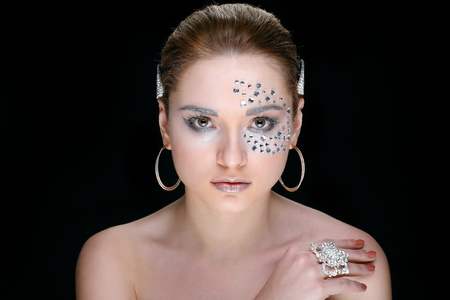 Portrait of sexual beautiful girl with strasses on face, on a black background Stock Photo