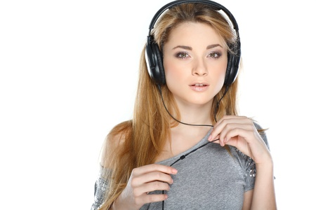 Beautiful girl with headphones isolated on a white background photo