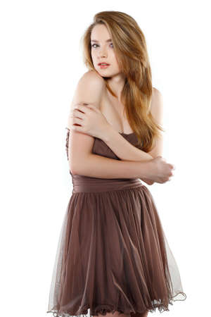 A beautiful young woman is in brown clothes, isolated on a white background Stock Photo - 11423888