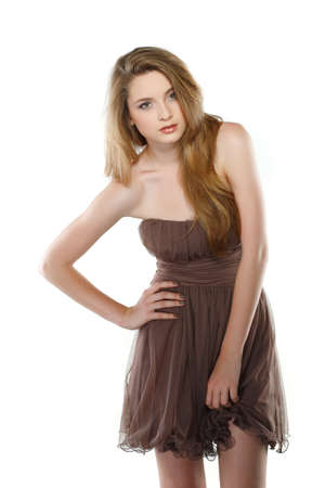 A beautiful young woman is in brown clothes, isolated on a white background photo