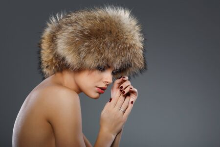 A photo of sexual beautiful girl is in fur clothes photo