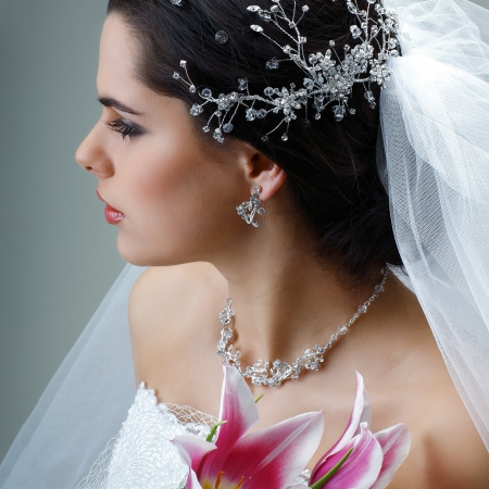 A brunette is beautiful in a wedding-dress, wedding decoration Stock Photo